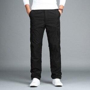 Image 2 - 男性のフリース貨物パンツ冬厚く暖かいパンツ全身マルチポケットカジュアル軍事だぶだぶ戦術的なズボンプラスサイズ 3XL