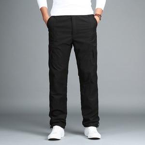 Image 2 - Calças de carga de lã masculina inverno grosso calças quentes comprimento total multi bolso casual militar baggy tático calças mais tamanho 3xl