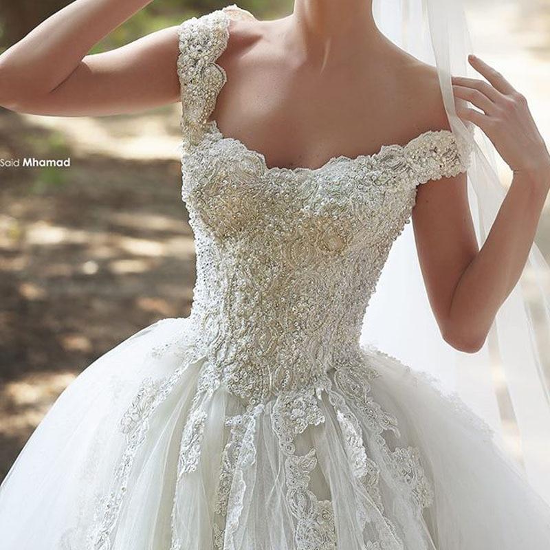 2015 Designer Said Elegant Appliqued Beaded Pearls Bling Bling Bodice Floor Length Puffy Princess Wedding Dresses