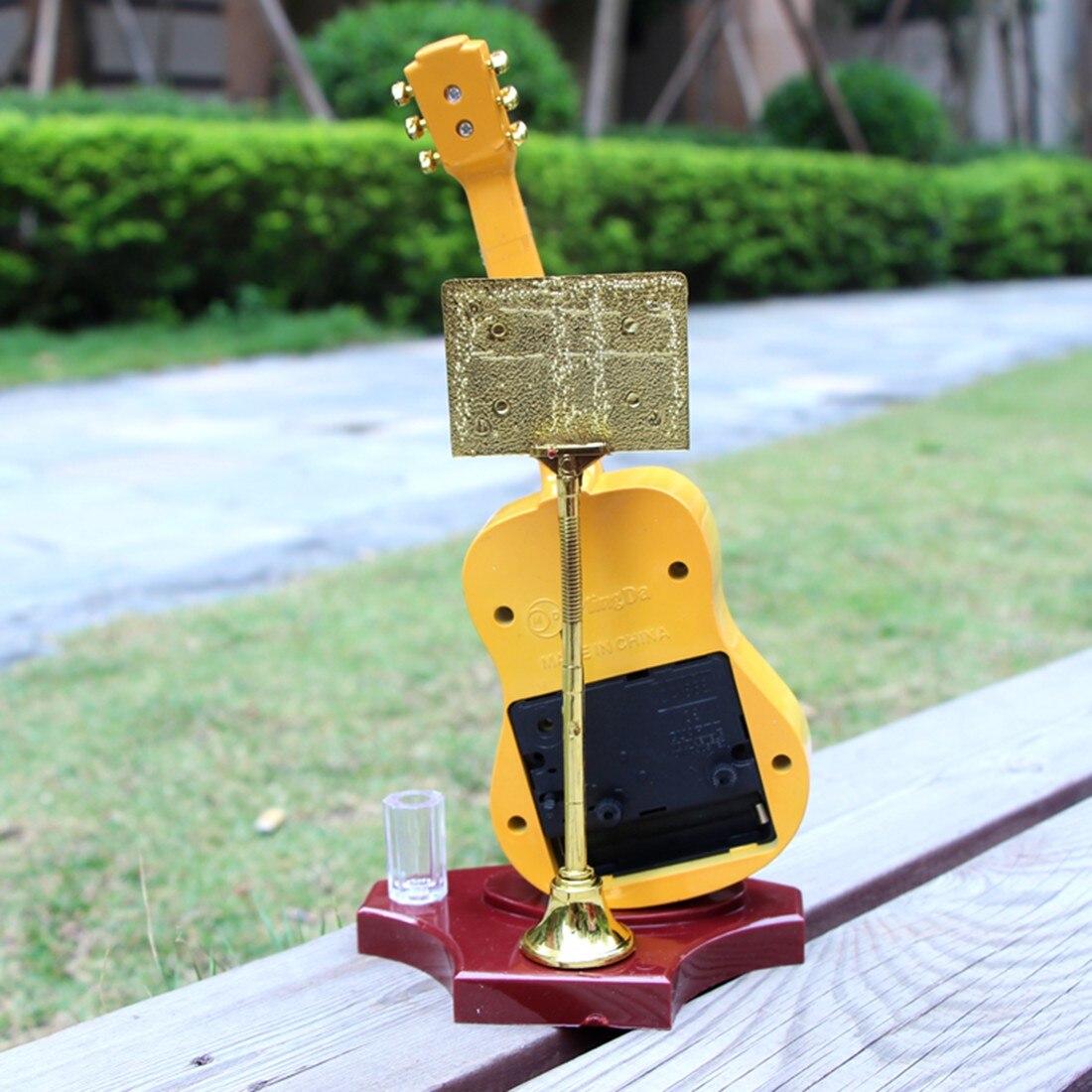 Criativo guitarra forma despertador de pé relógio