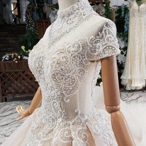 Image 4 - HTL634 elegante vestido de novia con tren de cuello alto de manga corta de encaje de cristal vestido de novia volante tren vestidos de noche vintage