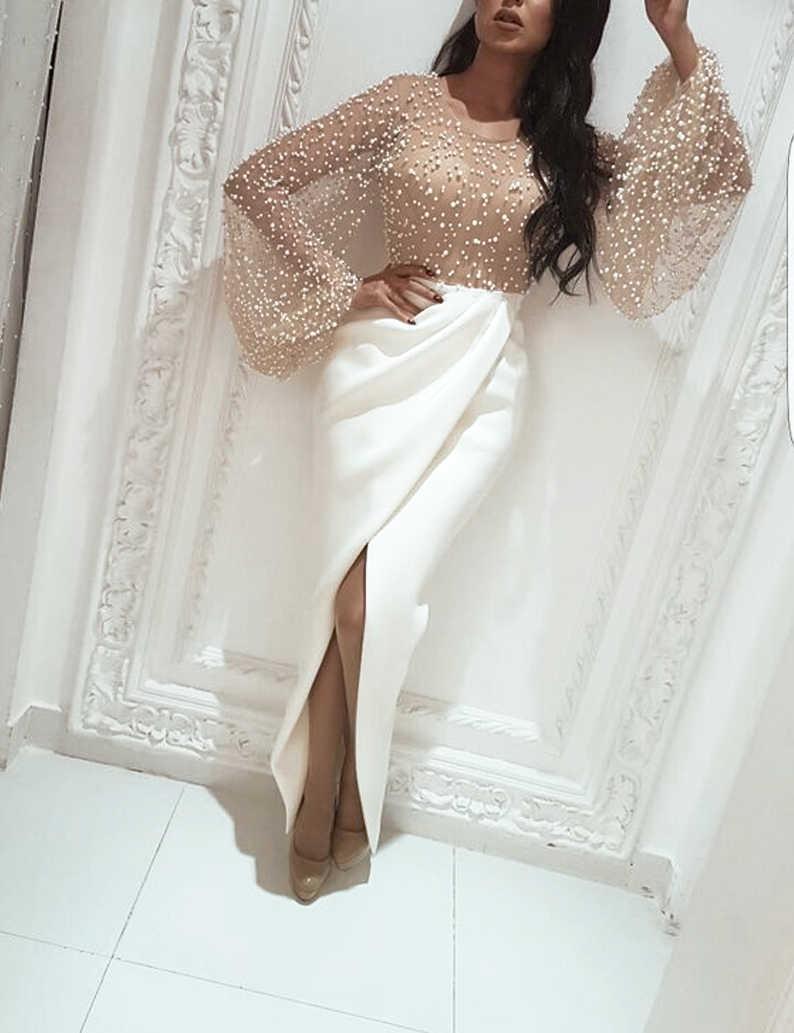 Женское платье в стиле пэчворк украшенное бисером с разрезом длинным пышным