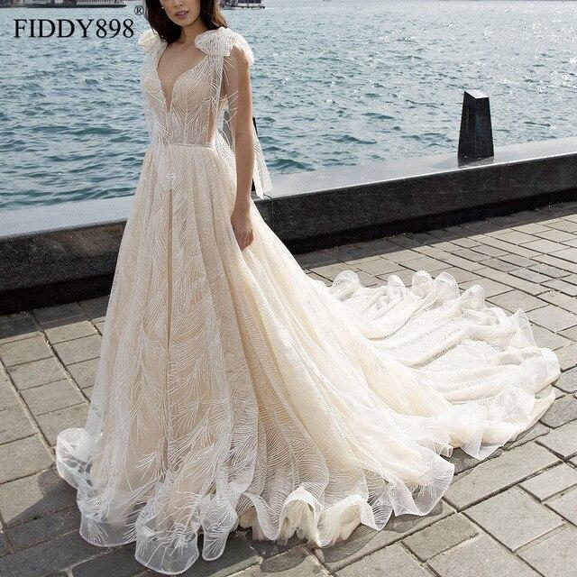 Lüks gelinlik 2020 V boyun şal boncuklu dantel gelinlik uzun tren şampanya gelin kıyafeti Robe de Mariee casamento