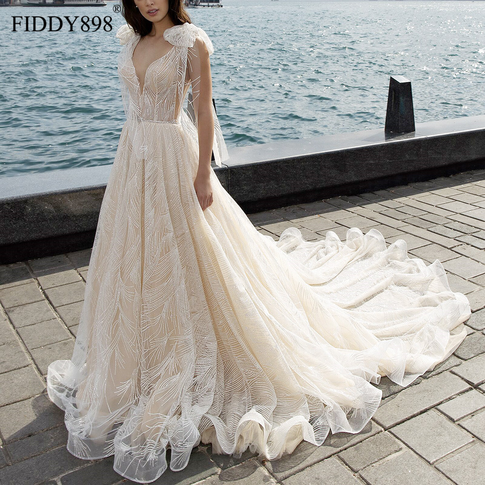 Luxury Wedding Dresses 2019 V Neck Shawl Beaded Lace Wedding Gown Long Train Champagne Bridal Gown Robe De Mariee Casamento