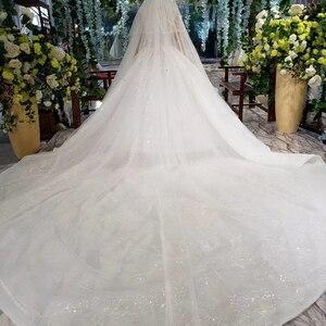 Image 2 - HTL823 فساتين زفاف لامعة مع الحجاب الزفاف الوهم o الرقبة فساتين زفاف طويلة مع الأكمام vestido de noiva 2020