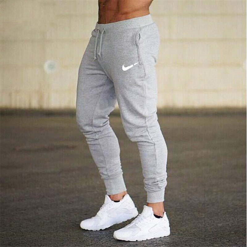 New Brand Print Logo Gyms Men Joggers Casual Men Sweatpants Joggers Pantalon Homme Trousers Sporting Clothing Bodybuilding Pants