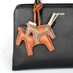 Image 5 - Designer Famous Brand Luxury Soft Real Genuine Leather Cute Horse Keychain Pendant For Backpack Animal Key Chain Women Bag Charm