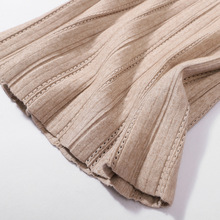 купить Pleated skirt autumn and winter faldas mujer moda 2019 new solid color jupe femme hollow autumn and winter knit skirt дешево
