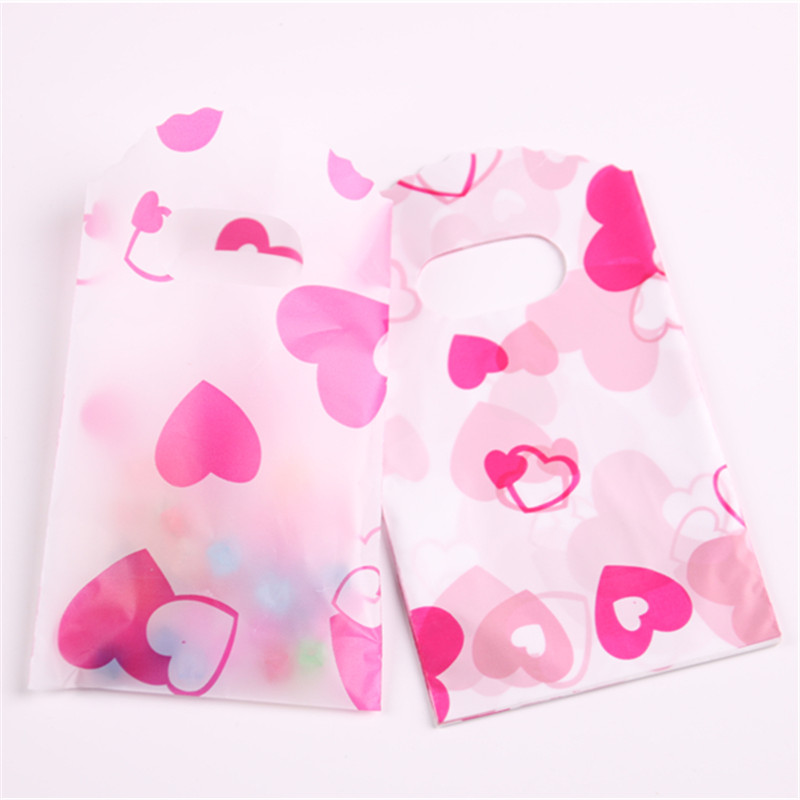 Fashion Style Wholesale 50pcs/lot 9*15cm Small Heart Plastic Gift Bags With Handles Packaging Gift Bags