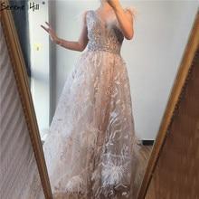 Dubaï Champagne col en v Sexy robes de soirée 2020 plumes cristal sans manches robes de soirée 2020 sereine colline LA70260