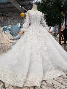 Image 3 - BGW HT4304 specjalne suknie ślubne z piórkiem przezroczyste plecy ręcznie robiony guzik suknia ślubna dla dziewczynki Vestido De Noiva Princesa