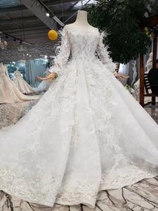 Image 3 - Bgw HT4304 特別ウェディングドレスと羽のためのシースルーバック手作りボタンブライダルドレス vestido デ noiva プリンセサ