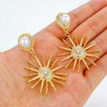 цена на AENSOA Alloy Point Rhinestone Inlay Pearl Fireworks Shape Drop Earrings Luxury Design Geometric Earrings For Women Party Jewelry