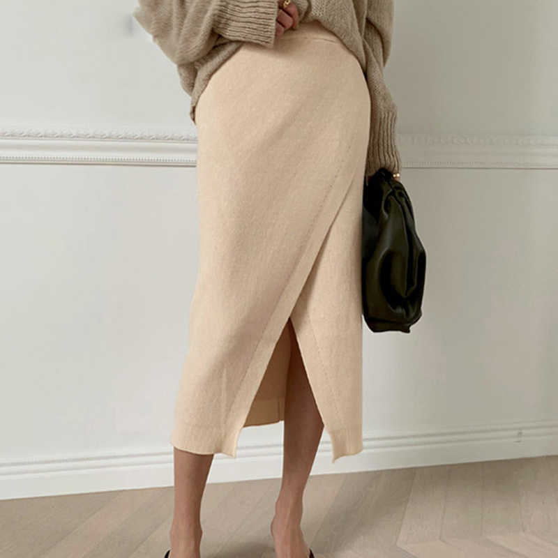 South Korea female autumn fashion personality bifurcate knitted skirts more pure color cultivate one's morality