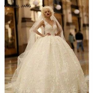 Image 1 - ¡Novedad de 2020! vestido de fiesta Sexy con cuello en V y encaje, hechos a medida vestidos de novia, sin mangas, lazo de vestido de boda, vestido bohemio con tren