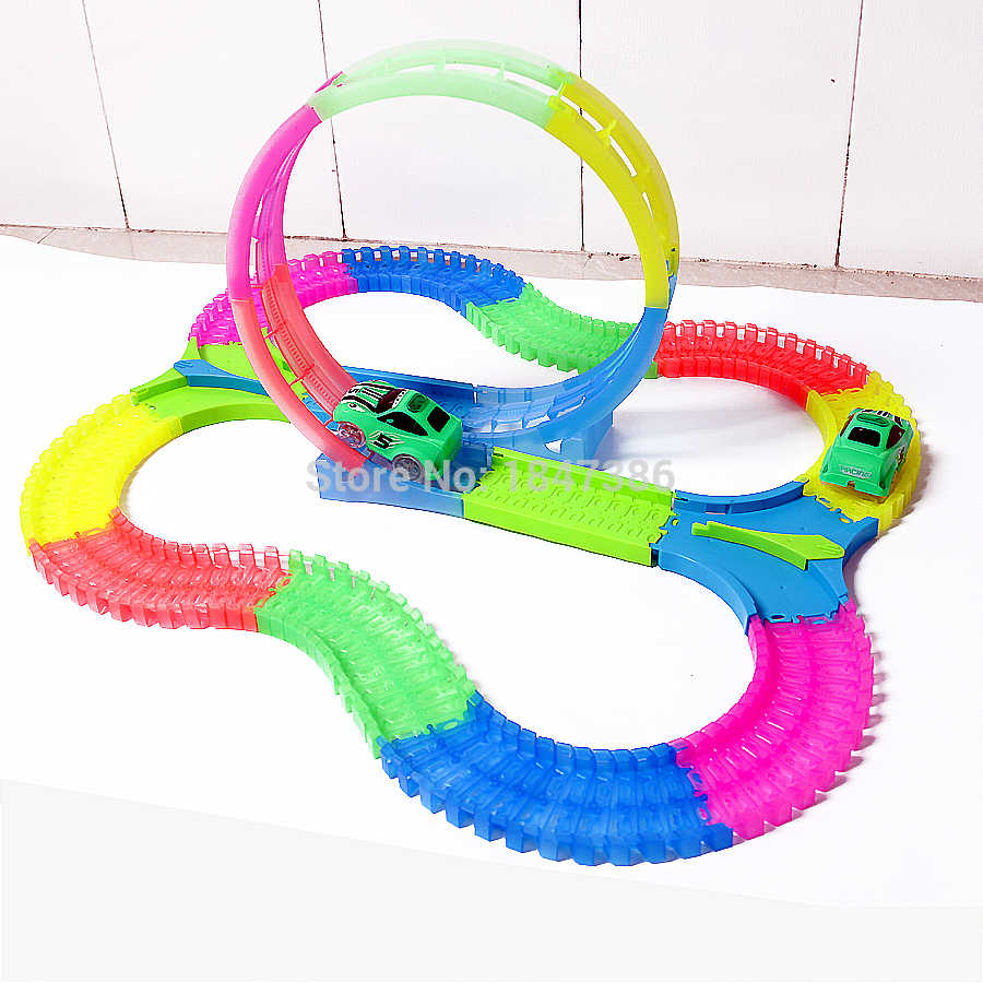 Magic Track DIY Glow race track 360 องศา Stunt Loop Glow in the Dark ยืดหยุ่นประกอบไฟฟ้ารถ Light -Up Race cars