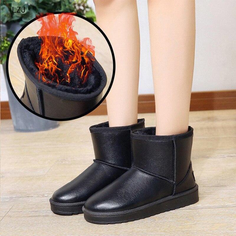 Nuevas botas de nieve de invierno para mujeres calientes de felpa corta suave señoras botas de tobillo de talla grande plataforma de piel para mujeres zapatos casuales de mujer