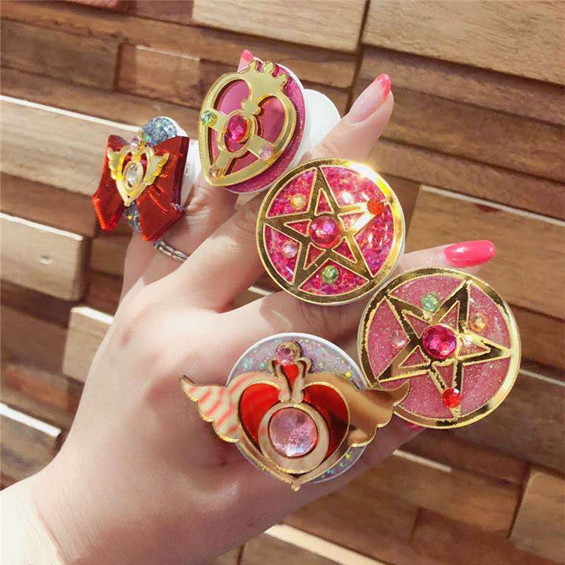 Random Style Sailor Moon Crystal Star Crisis Moon Finger Cosmic Heart Ring Holder Stand For Phone