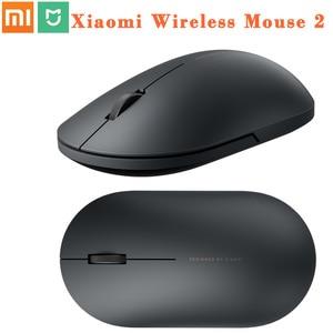 Image 1 - 100% oryginalny Xiaomi MI przenośna mysz zdalny bezprzewodowy optyczny RF 2.4GHz Dual Mode podłącz komputer Windows 7 / 8 / 10