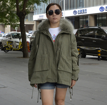 Women winter fur coat ,park with lining loose Loose style big size and two colors