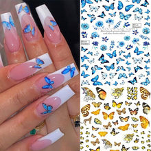 Adesivi farfalla Nail Art farfalle blu fiori rosa 3D decalcomanie di trasferimento disegni acrilici colla posteriore adesivo Manicure Slider