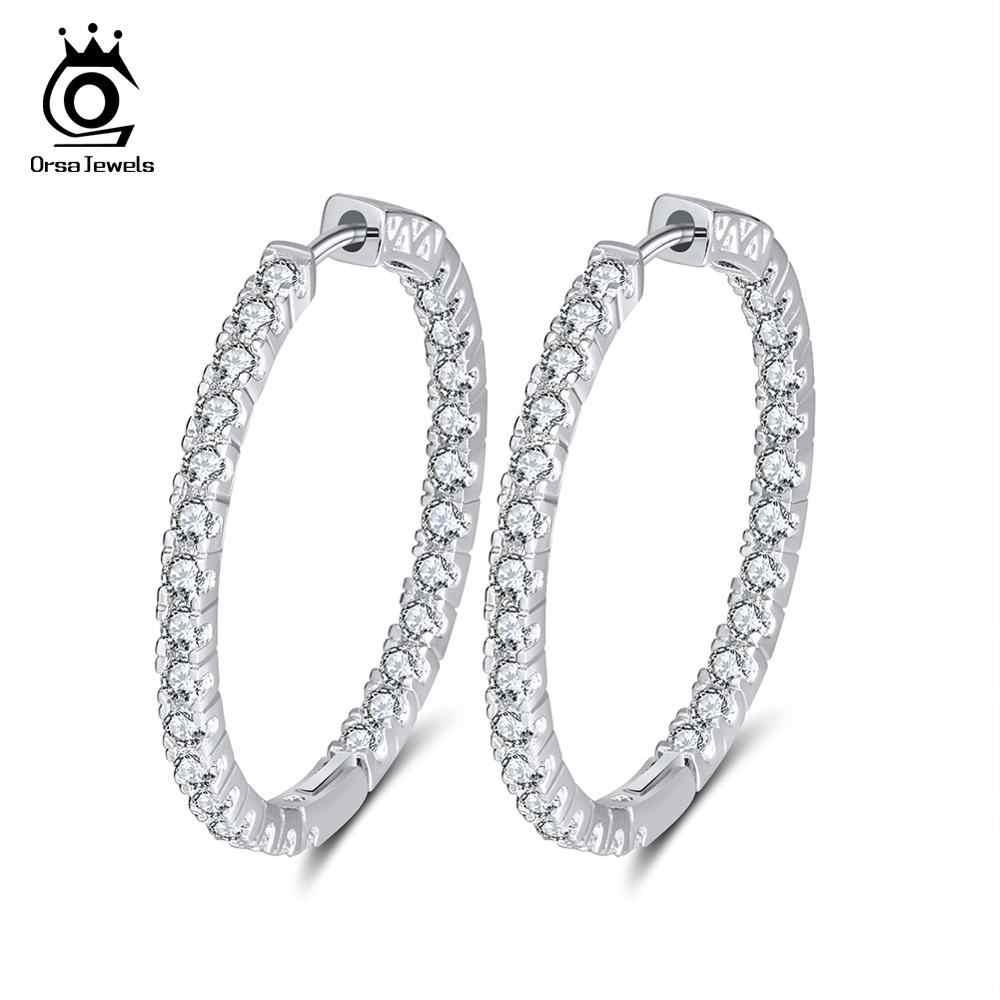 ORSA JEWELS Elegantes y exclusivos pendientes circulares chapados en plata, adornados con circonio cúbico austriaco AAA. Joyería para fiesta OE137