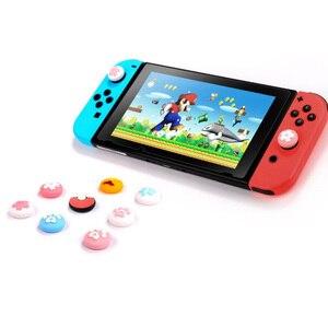Image 3 - Słodki kociak łapa pazur Sakura uchwyt na kciuki czapka Joystick pokrywa na przełącznik do nintendo Lite Joy Con kontroler Gamepad Thumbstick Case