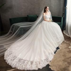 Image 4 - Neue Ankunft Süße Elegante Prinzessin Luxus Spitze Hochzeit Kleid 100 cm Boot ausschnitt Appliques Promi Ballkleid vestido De Noiva