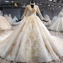 아이보리 긴 소매 웨딩 드레스 여성을위한 골드 레이스 2020 공주 푹신한 V 넥 코르셋 실제 사진 빈티지 브라 가운