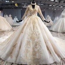 Elfenbein Lange Ärmel Hochzeit Kleider mit Gold Spitze für Frauen 2020 Prinzessin Puffy V ausschnitt Korsett Real Fotos Vintage Braut kleider