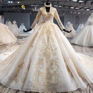 Image 1 - Ivoor Lange Mouwen Trouwjurken Met Gouden Kant Voor Vrouwen 2020 Prinses Puffy V hals Corset Real Foto Vintage Bridal jassen