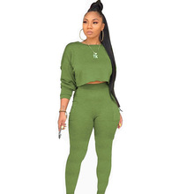 women's fashion round neck long sleeve pocket pants set solid color two-piece Sets Spring 2019  European and American