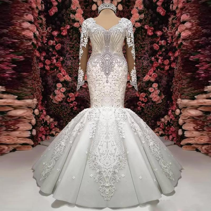 2020 New Gorgeous Crystal Lace Applique Mermaid Wedding Dresses Long Sleeve V-Neck Ruffle Puffy Bottom Bridal Gown Sheer Back