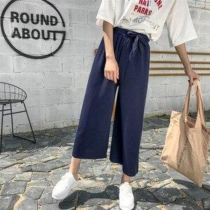 Image 3 - Женские свободные брюки палаццо, Элегантные повседневные брюки в стиле преппи с широкими штанинами, однотонные брюки, 2020