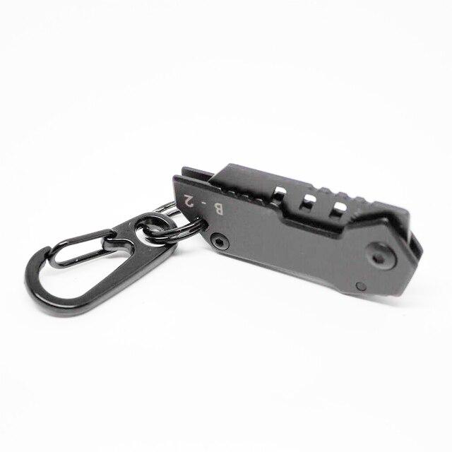 Mini couteau porte clé outil extérieur Nano Hoja Mini Cuchillo Militar Suizo Que Lleva De Acero Llavero Plegable Camping