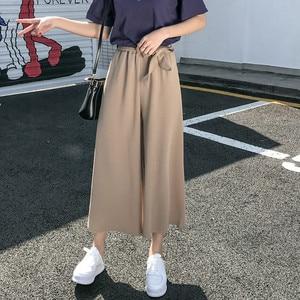Image 1 - Женские свободные брюки палаццо, Элегантные повседневные брюки в стиле преппи с широкими штанинами, однотонные брюки, 2020