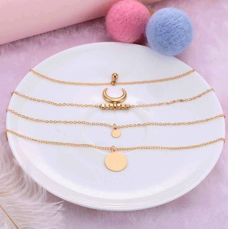 グラマーネックレスファッション新しいレトロなエスニック風ムーンホーンホーンゴールド多層女性ネックレス 4 層ネックレス