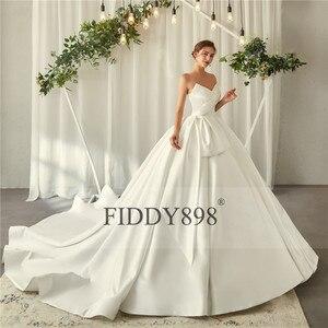 Image 4 - ロイヤルウェディングドレス 2020 V ネックソフトサテンのウェディングドレスふくらん夜会服フリルブライダルガウンロングトレイン Vestido デ noiva