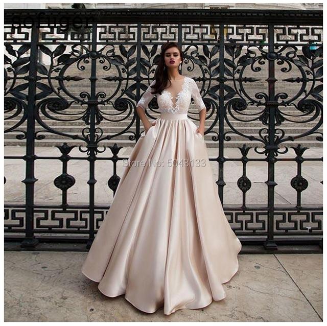 Modeste Satin robes de mariée avec poche Vestido de Noiva dentelle demi manches robe de mariée 2021 étage longueur Champagne robes de mariée