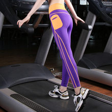 New mobile phone pocket lady pants lady fashion fitness nine-point pants running tights(China)