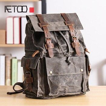 цена AETOO Shoulder bag, male canvas stitching leather backpack, retro large capacity travel bag, oil wax waterproof bag онлайн в 2017 году