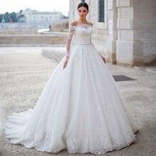 Скромные кружевное фатиновое платье трапециевидной формы свадебные