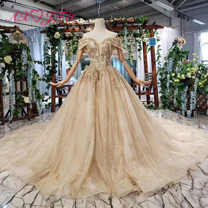 Image 1 - AXJFU Luxury princess golden flower lace boat neck beading crystal sparkly star bride tail wedding dress 100% real photo 11669