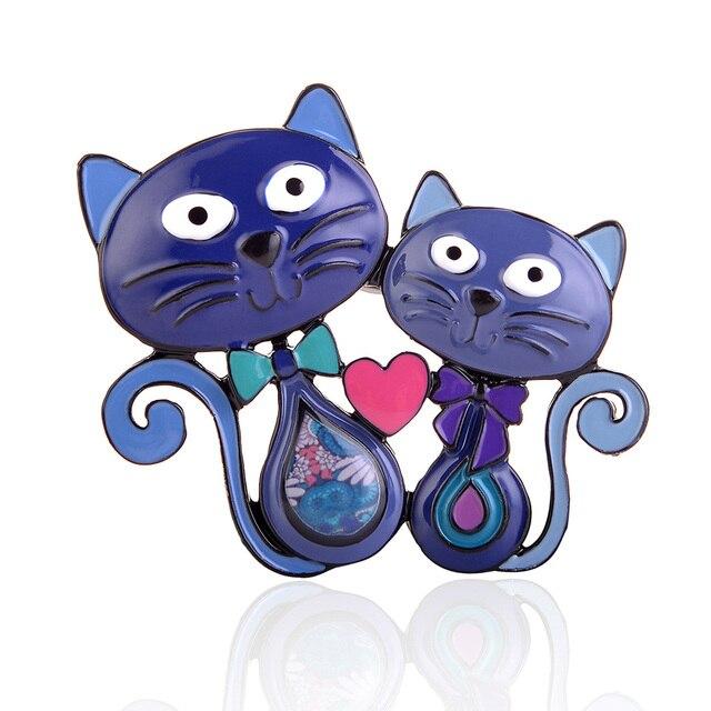 Cat in heart brooch