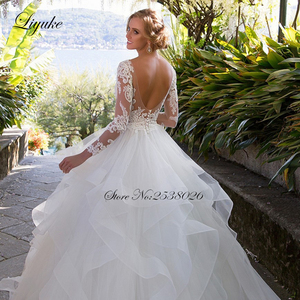 Image 5 - Liyuke الكشكشة ألف خط فستان زفاف الأميرة مع كم طويل من فستان عروس بلا ظهر