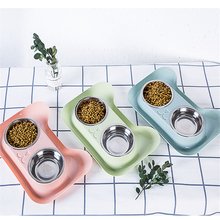 Pet food plate with double cat face port