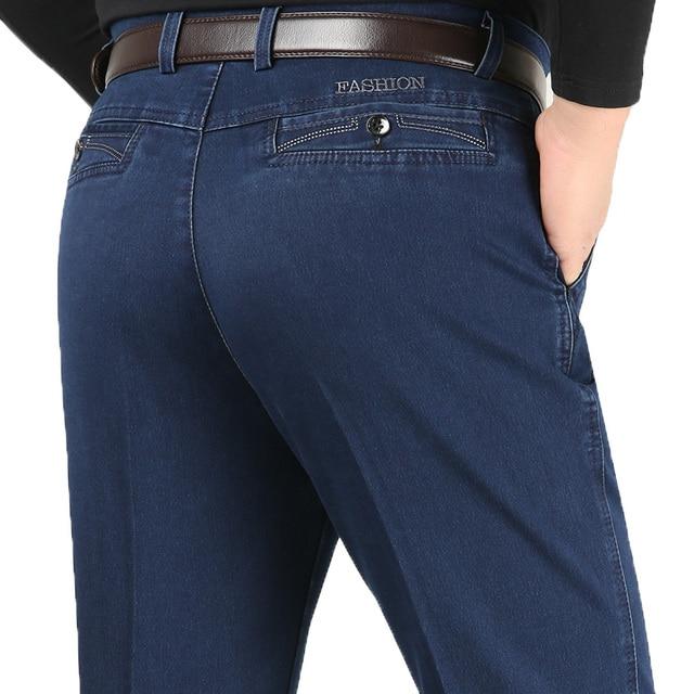 Artı boyutu 30 42 erkekler kaliteli Denim kumaş kot Homme yüksek bel streç düz katı pantolon erkek klasik eğlence pantolon