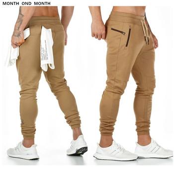 Spodnie do biegania męskie spodnie dresowe dla joggerów spodnie na siłownię na co dzień trening Fitness odzież sportowa modne spodnie męskie spodnie bawełniane spodnie ołówkowe tanie i dobre opinie Month ond month Spodnie krzyżowe CN (pochodzenie) High Street Sznurek Plisowana Pełnej długości Poliester COTTON Luźne