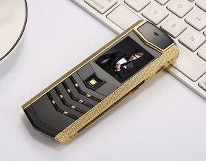 Image 1 - Czyszczenie magazynu wyprzedaż luksusowy metal + skórzany telefon komórkowy oryginalny chiny gsm prezent telefon dual sim telefony komórkowe bluetooth mp3 K8 K6 telefon