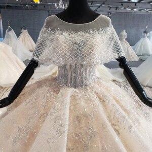 Image 4 - HTL1066 Peplum Kraal Parel Trouwjurken Applique Lace Up Back Vrouwen Jurk Bruiloft Glitter Свадебное Платье